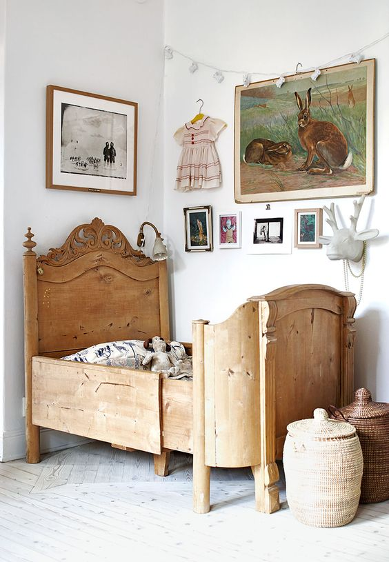 a vintage wooden bed, wicker baskets and vintage artworks for a cool look