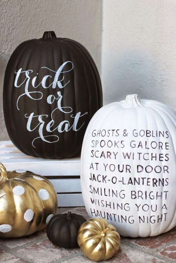 modern black and white pumpkins with letters and gold polka dot ones for a cute touch