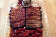 07 sausage and ribs display with a skull for a pirate-themed Halloween party