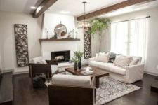 08 a cozy living room with stucco walls and wooden beams for a chic look