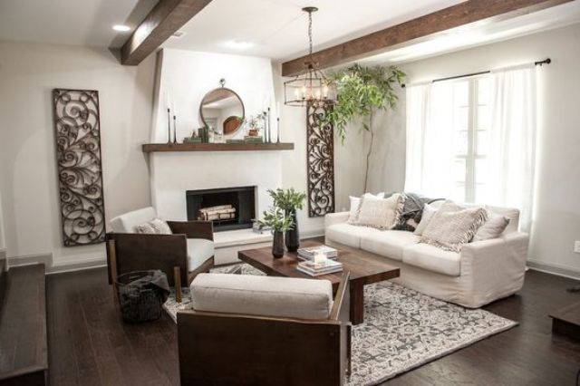 a cozy living room with stucco walls and wooden beams for a chic look