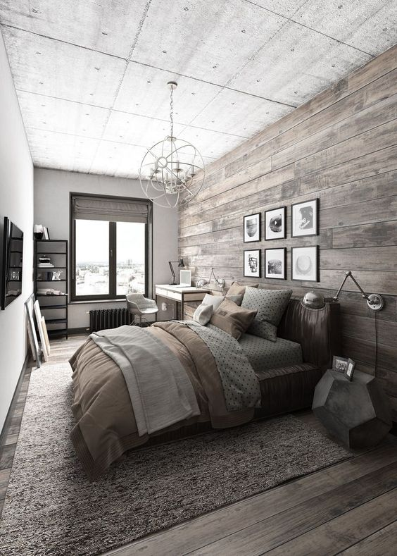 a reclaimed wood wall and floor, a leathe rupholstered bed give a cozy rustic feel