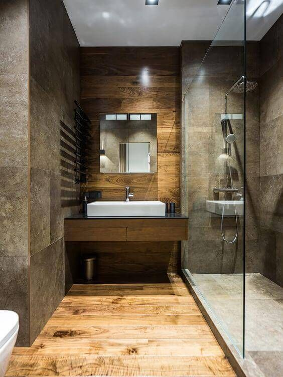 stone effect tiles and matching waterproof wood look textural in this modern space