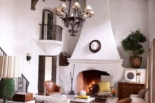 09 a Spanish colonial style living room with stucco walls and a stucco fireplace looks very elegant