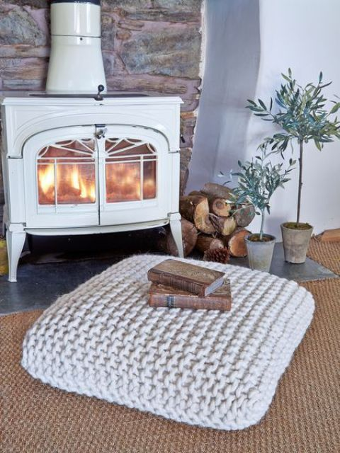 a chunky knit floor pilows can be used as an ottoman, a pouf or a footrest