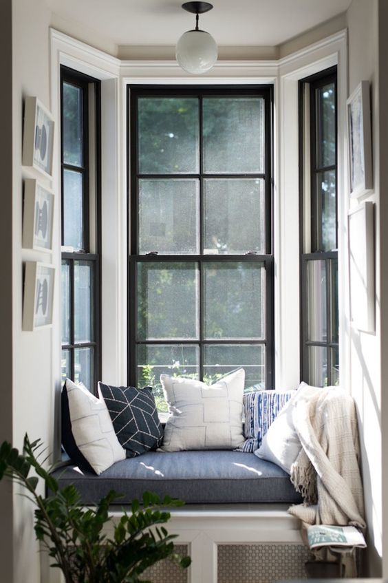 a comfy windowsill seat with pillows and a cushion is ideal for reading