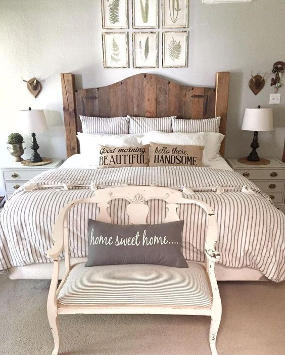 a reclaimed wood bed and a vintage seat at the footrest bring a rustic feel