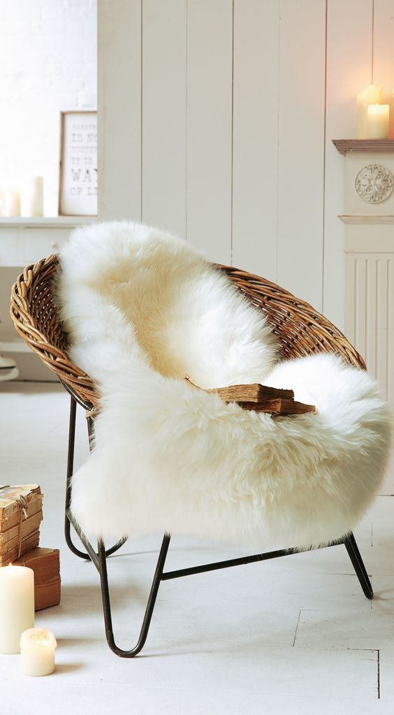 a usual wicker chair can be covered with faux fur and easily turned into a winter piece