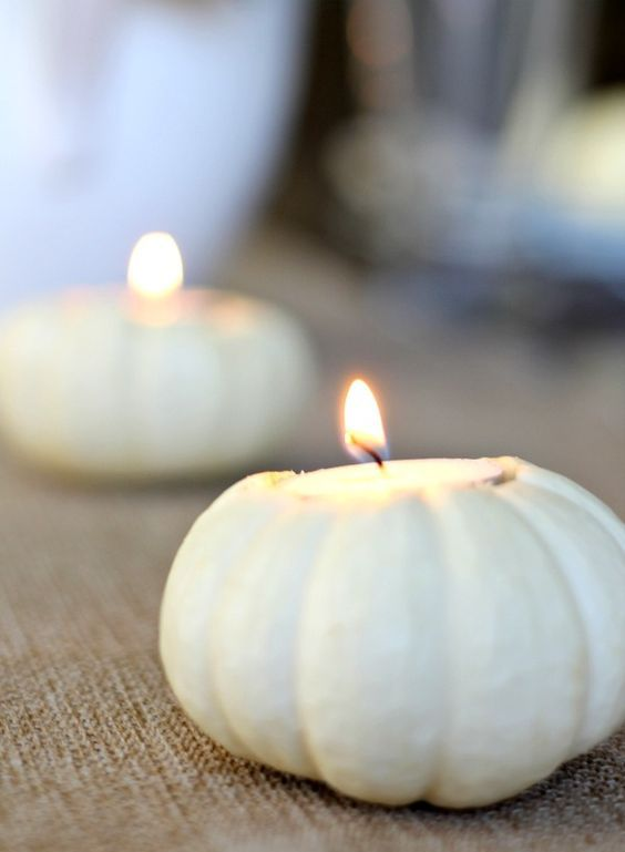 white pumpkins can be used as candle holders for elegant decor