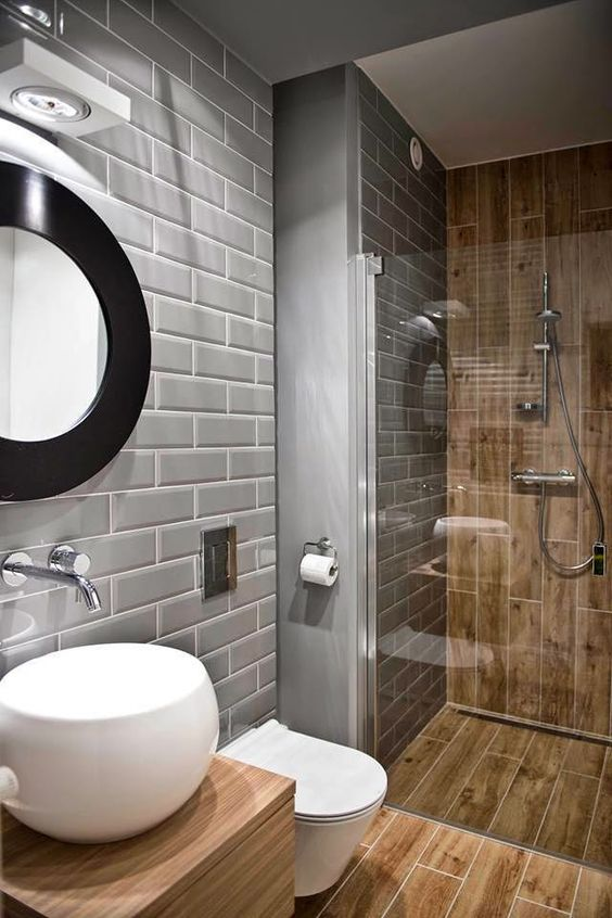 wood effect tiles of a warm shade contrast grey tiles and look interesting