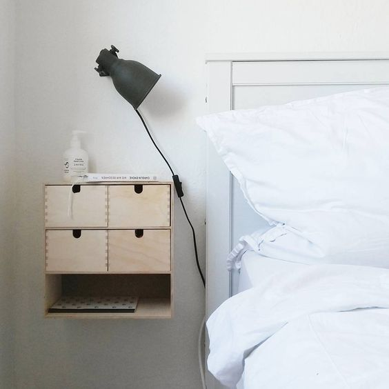 Ikea Moppe attached to the wall as a space-saving nightstand