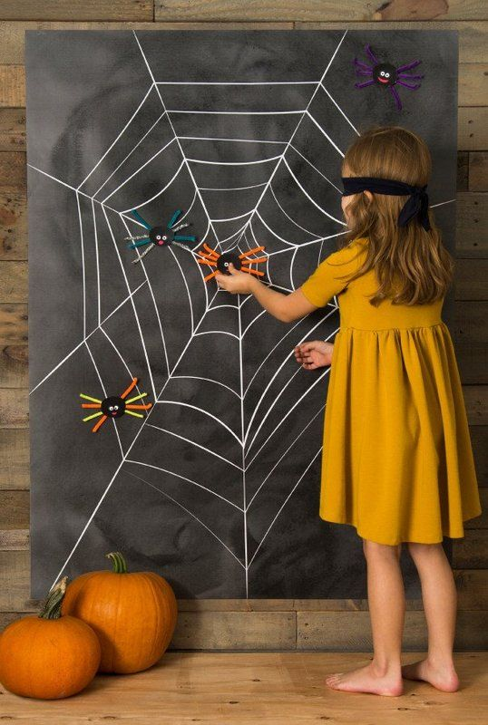 a chalkboard Halloween board used for a kids' party game