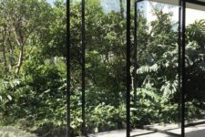 10 a wall of pivoting glass doors makes you feel like outdoors