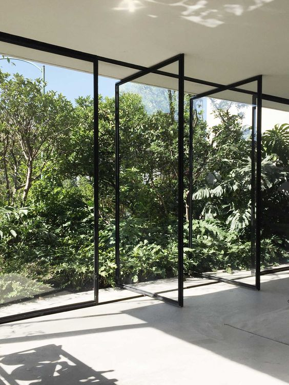 a wall of pivoting glass doors makes you feel like outdoors