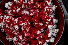 10 bloody popcorn is an easy dessert to make and will fit any party theme