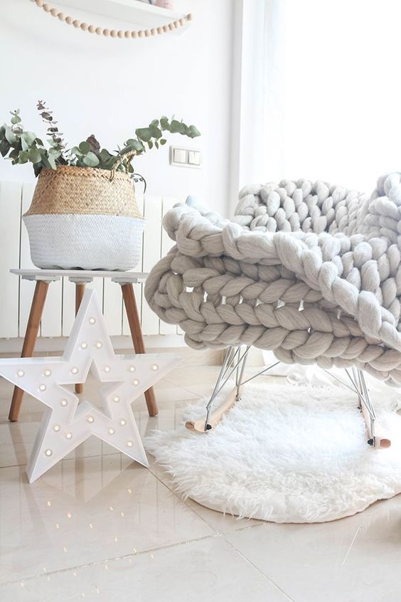 a chunky knit blanket and a faux fur rug is a great duo for a winter or fall space