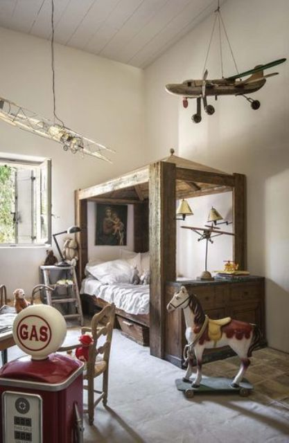 a vintage reclaimed wood bed with framing and a sideboard attached for a boy's room