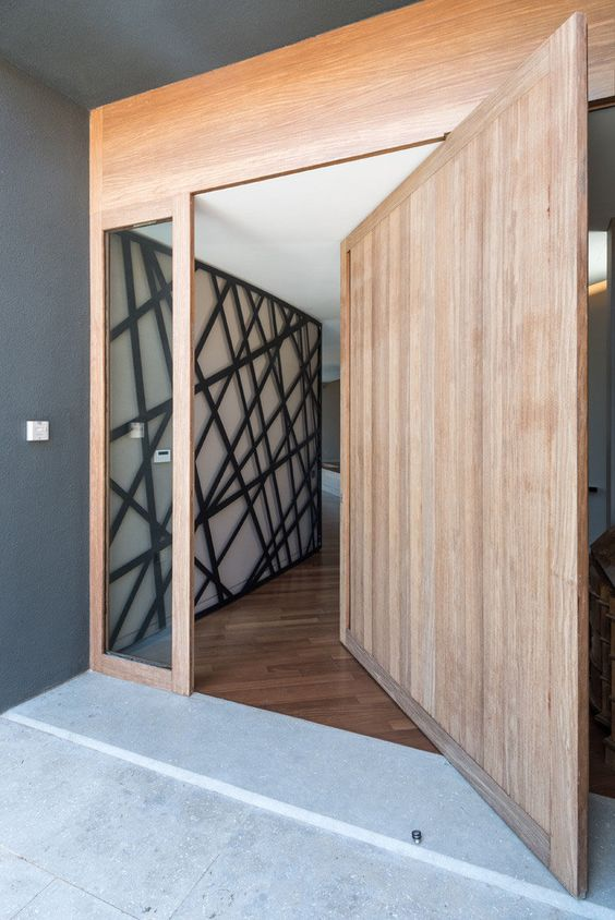 a wooden pivoting door can cause warping and become not very stable