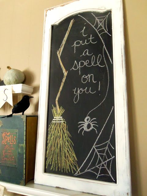 a chalkboard sign made in an old window is a creative and easy DIY