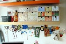 12 a colorful Ikea Moppe with various types of wallpaper placed on a shelf