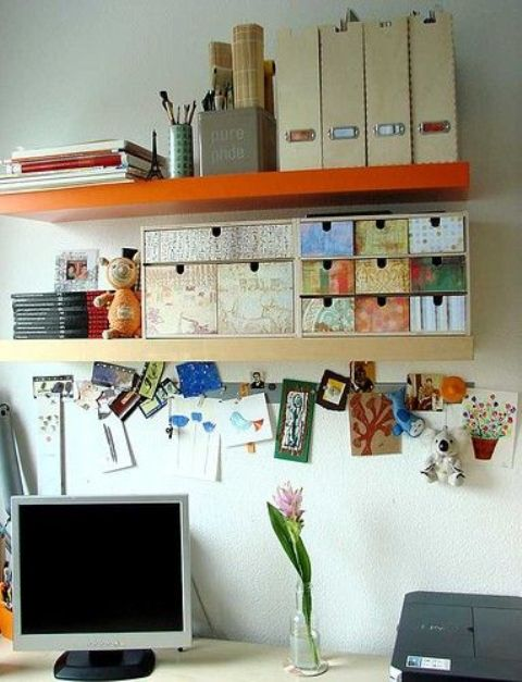 a colorful Ikea Moppe with various types of wallpaper placed on a shelf