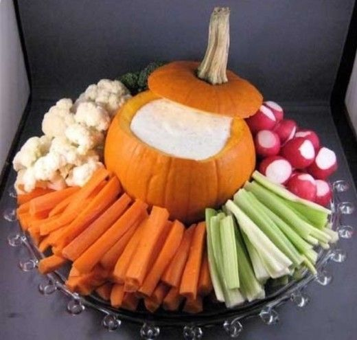 a gorgeous tray with a pumpkin holding sauce and fresh veggies placed around