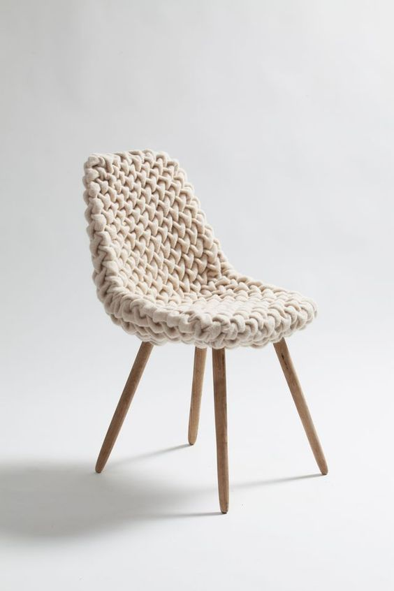a usual chair with a chunky knit cover becomes cozier and more welcoming