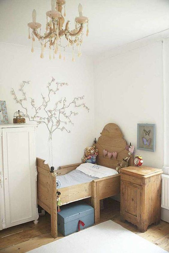 a wooden bed and nightstand create a cozy ambience, and that's what a kid needs for sleep