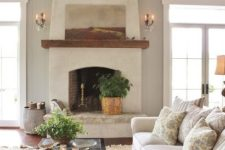 stucco walls and a fireplace for a rustic vintage space, and wooden beams to add coziness