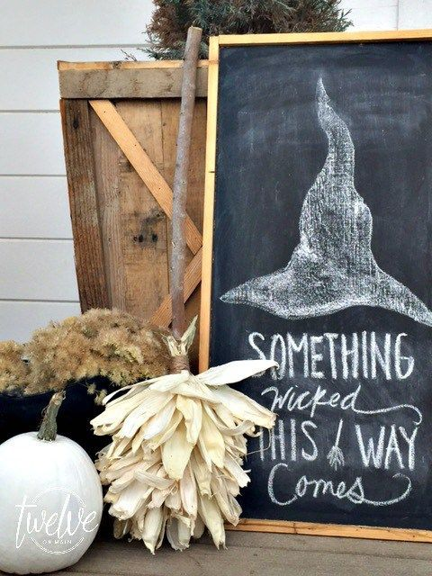 a chalkboard sign with a witch-inspired artwork