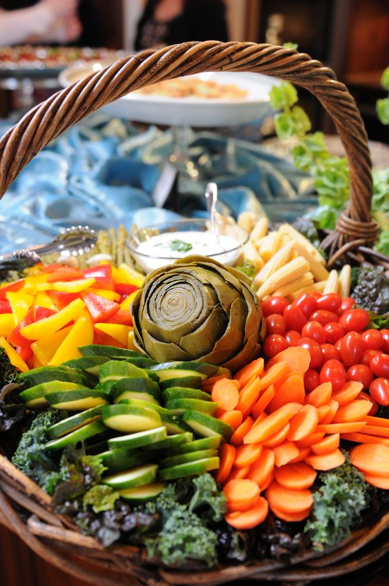 a veggie tray served in a basket looks very rustic and cozy, it's a unique idea