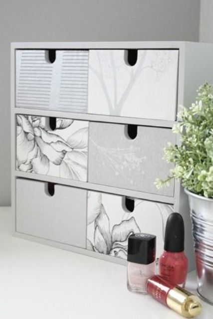 an Ikea Moppe hack with various wallpaper in grey for a makeup nook