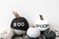 13 black, silver and white pumpkins with glitter and traditional spooky words