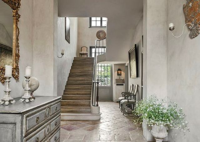 stucco walls and stone floors create a beautiful vintage space