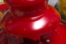 14 a chocolate fountain with red tinted chocolate will strike every guest at the party