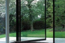 14 a glass pivoting door in metal framing won't warp