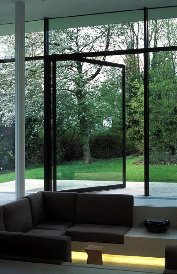 a glass pivoting door in metal framing won't warp