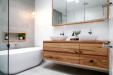 14 a light-colored timber vanity with a textural look is great for a modern space