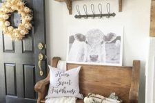 14 a wooden bench with birch branches and greenery, a pumpkin and corn husk wreath