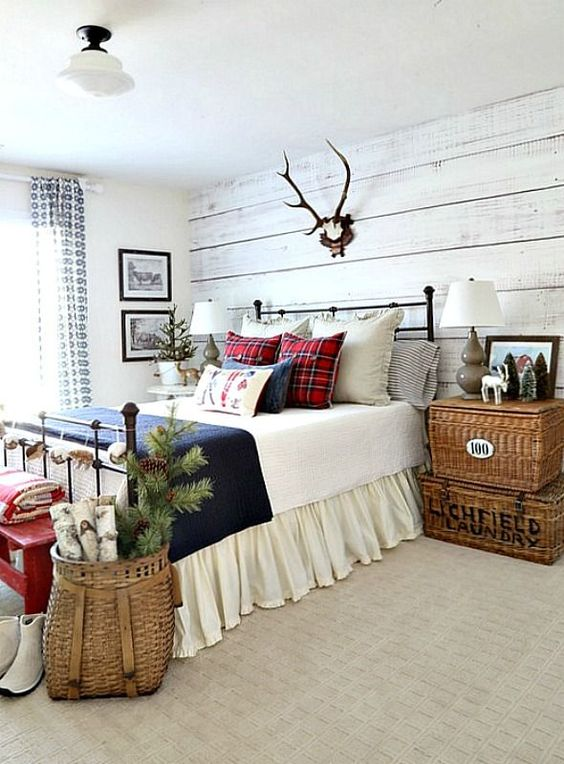 a whitewashed wood wall, wicker baskets, antlers and plid prints for a rustic feel