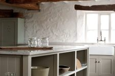 15 this rustic kitchen looks amazing with stucco walls and wooden beams