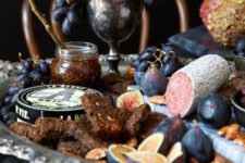 16 a chic salami, cheese and honey display for a vintage or vampire-inspired Halloween dinner
