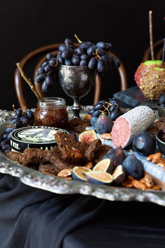 a chic salami, cheese and honey display for a vintage or vampire inspired Halloween dinner