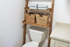 16 a wooden ladder with baskets as a smart bathroom storage