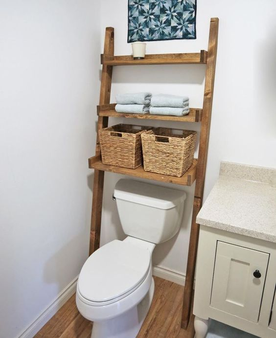 a wooden ladder with baskets as a smart bathroom storage
