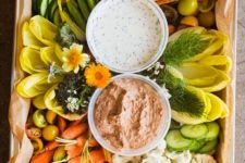16 organic fresh veggies platter with two kinds of dip in bowls looks very stylish