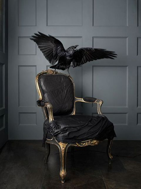 take a vintage chair, cover it with black cloth and gild the framing, attach a faux raven and voila, stylish decor is ready