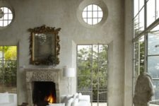 16 unfinished plaster walls, exposed beams and stone paver flooring give a feeling of raw glamor