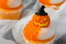 23 Halloween cupcakes with orange syrup and edible pumpkin toppers