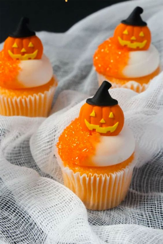 Halloween cupcakes with orange syrup and edible pumpkin toppers